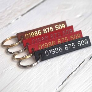 Personalised red, tan, choc and black leather id tags embossed with your telephone number