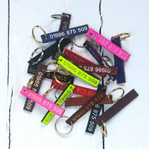 Personalised leather id tags embossed with your telephone number