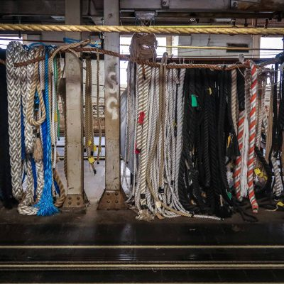 Sample pieces of rope hanging up on the rope walk